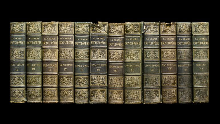 Old books on shelf. French encyclopedia